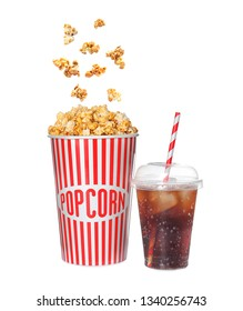 Carton cup with delicious caramel popcorn and iced cola on white background