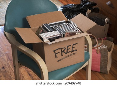 carton of free CDs and DVDs