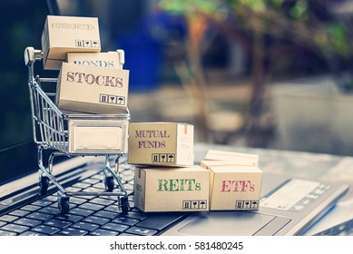 Cartons of financial instruments and a shopping cart. Idea about portfolio selection that collects risky assets combined with different weights to provide acceptable trade off between risk and return.