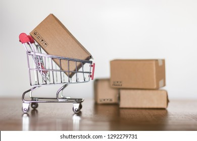 Cartons and trolley. Shopping concept