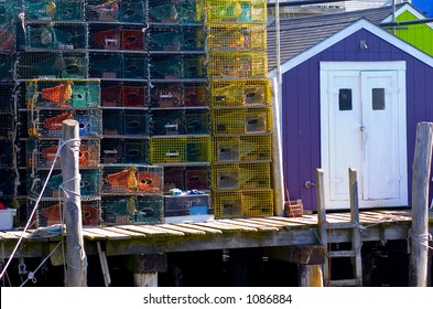 A cartoon-like mix of colors found on a fishing pier in Maine featuring colorful buildings and lobster traps.