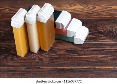 cartridge for wax epilation on a wooden background