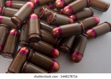 Cartridges bulk close up images. Bullets in shells for gun are piled randomly. Weapon armory concept