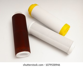 Cartridges for water filters. White background.