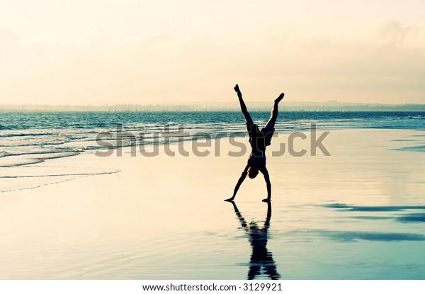 Cartwheel on a deserted beach
