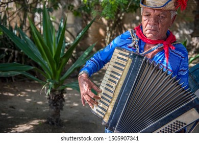 Caruaru, Pernambuco, Brazil - July 11, 2016: Man wearing traditional clothes and straw hat plays accordion during Brazilian June parties (São João)