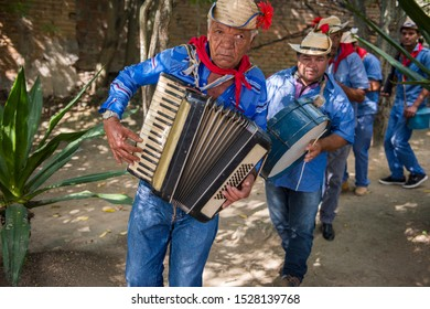 Caruaru, Pernambuco, Brazil - July 11, 2016: Men wearing traditional clothes and straw hat plays accordion during Brazilian June parties (São João)