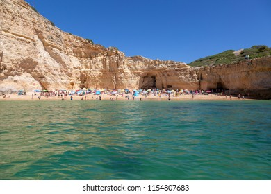 CARVALHO, PORTUGAL- July 27th, 2018: Sea view of tourists and locals enjoying Carvalho beach on a hot sunny day