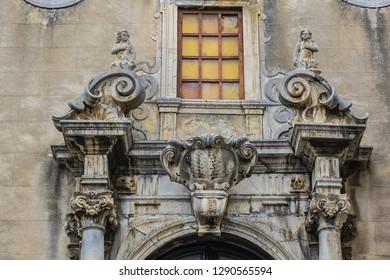 Carved Baroque portal of Santo Stefano Church also known as church of Purgatory (Chiesa del Purgatorio, 1668) at Piazza Giovanni in Cefalu, Sicily, Italy.