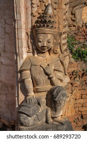 Carved bas-relief of a female figure on a wall of ancient ruined Buddhist temple in Indein, Inle lake area, Myanmar