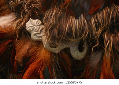 Carved bone Maori decoration used as a pin on a traditional cloak