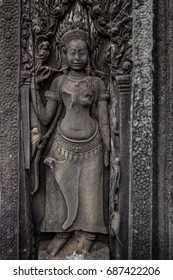 Carved depiction of apsara, mythical female spirit in hinduism and buddhism, on a wall of Bayon temple in Angkor Wat area, Siem Reap, Cambodia