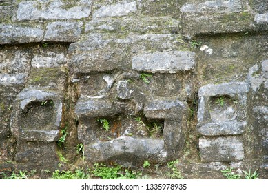 The carved face on a side of Mayan temple in ancient Altun Ha archaeological site in Belize.