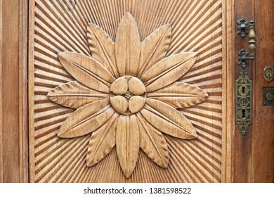 Carved flower on wooden door texture background