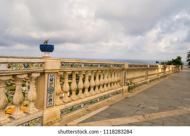 Carved handrail with ceramic pattern and surmounted by a blue basin with a cactus in the city Santo Stefano di Camastra in northern Sicily