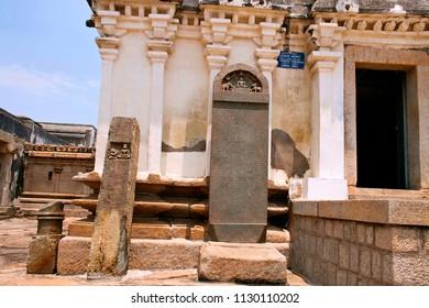 Carved inscriptions in Kannada on the stone pillar at the entrance of Shasana or Sasana Basadi Chandragiri hill, Sravanabelgola, Karnataka
