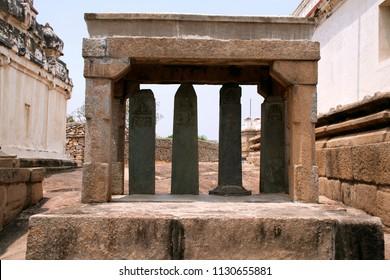 Carved inscriptions in Kannada on the stone pillars, Eradukatte Basadi, Chandragiri hill, Sravanabelgola, Karnataka