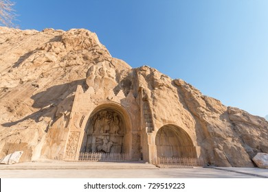 Carved into the rock, place with a several reliefs from the era of Sassanid Empire of Persia. Winter season, shortly after sunrise. Iran, Persia, Taq-e Bostan, Arch of the Garden or Arch made by stone