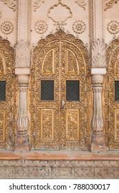 carved Islamic ornament wooden temple door in Vrndavana, India
