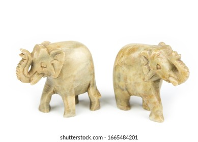 Carved marble elephant on a white background