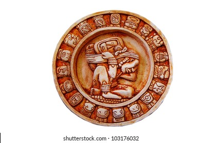 A carved Mayan calendar isolated on white