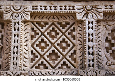 Carved Patola (Double Ikat) pattern on the inner wall of Rani ki vav, an intricately constructed stepwell on the banks of Saraswati River. Patan, Gujarat, India