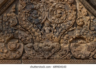 Carved pediment with bas-relief of Hindu god Indra sitting on a kala, mythical creature symbolizing time, in Banteay Srey temple (Citadel of women) dedicated to Lord Shiva near Siem Reap, Cambodia
