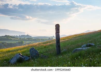 Carved pole portraying Slavic pagan gods at Turcianska Stiavnicka. - Shutterstock ID 1995245660