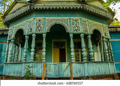 The carved porch of an old wooden abandoned house in Pushcha-voditsa village, Kiev region, Ukraine.
