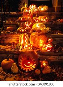 Carved Pumpkins for halloween on the doorstep.