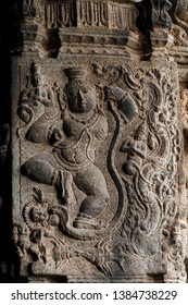 Carved sculpture of Hindu god on the external walls of the Kanchipuram temple in Tamil Nadu, India.
