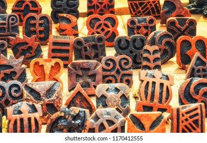 Carved stamps are used to print symbols on traditional Adinkra cloth made by the Ashanti people in Ghana.