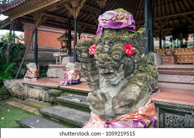 Carved statue of balinese demon in Ubud palace on Bali, Indonesia
