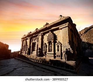 Carved statues in ruined building at sunset in Ellora cave near Aurangabad, Maharashtra, India