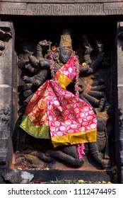 Carved stone idol of Mahishasur Mardini slaying  demon buffalo, Nataraja Temple, Chidambaram, Tamil Nadu. It is one of the five holiest Shiva temples, representing one of the five natural elements