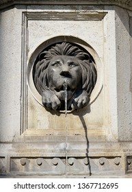 A carved stone lion's mouth serves as a waterspout in a detail from a 15th century fountain on the street, Graben, in Vienna, Austria