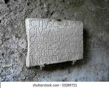 Carved stone panel in Latin at the ancient Roman city of Pompeii, which was destroyed and buried during the eruption of Mount Vesuvius in 79 AD