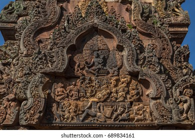 Carved stone pediment with bas-relief of Hindu god Shiva with wife Parvati sitting on holy mountain Kailash that is shaken by Ravana in Banteay Srey temple (Citadel of women) near Siem Reap, Cambodia