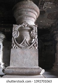 Carved stone pillars inside the Ellora Caves