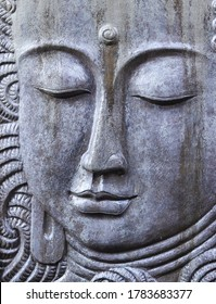 carved stone in the shape of a buddha statue