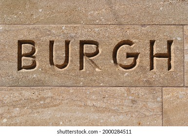 Carved Stone Sign in Old Stone Wall 'Burgh'