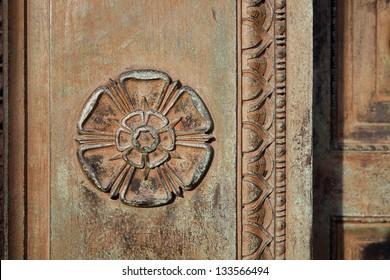 Carved Tudor Rose on an ornamental doorway