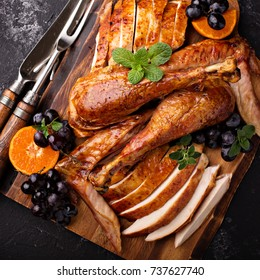 Carved turkey on a cutting board for Thanksgiving or Christmas overhead shot