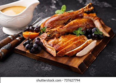 Carved turkey on a cutting board for Thanksgiving or Christmas with gravy