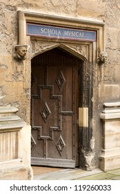 Carved wooden door at entrance to School of Music at Bodeian Library University of Oxford