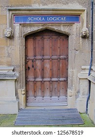 Carved wooden door at entrance to School of Logic, Bodleian Library, Oxford, United Kingdom.