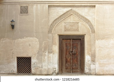 Carved wooden door and ornate doorway in a courtyard of traditional Arabian house of pearl trader Shaikh Isa bin Ali, Muharraq, Bahrain