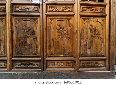 Carved wooden doors of an old house of a Chinese merchant, city of Xi'An , China  - 08/06/18