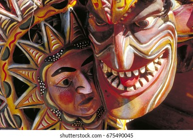 Carved wooden fiesta masks in Mexico.