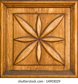 Carved wooden floral detail with a frame